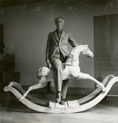 Max Ernst with rocking horse, Paris ,1938, Max Ernst Museum Brühl des LVR, Stiftung Max Ernst