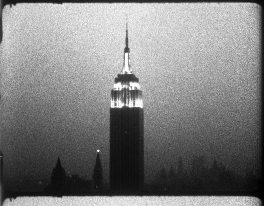 Andy Warhol (1928–1987), Empire, 1964. 16mm, b&w, silent; 8 hrs., 5 min. at 16 fps, 7 hrs., 11 min. at 18 fps © 2018 The Andy Warhol Museum, Pittsburgh, PA, a museum of Carnegie Institute. All rights reserved