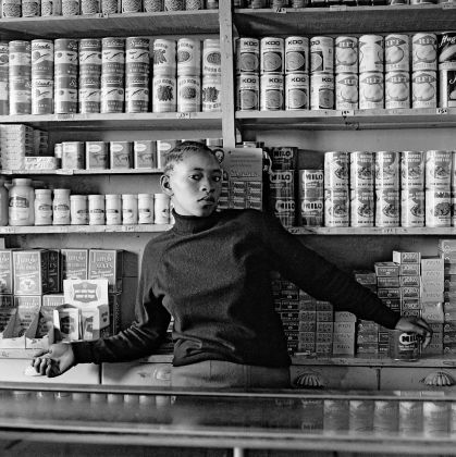 David Goldblatt, Shop assistant, Orlando West, 1972, silver gelatin photograph on fibre-based paper. Image courtesy Goodman Gallery, Johannesburg and Cape Town © The David Goldblatt Legacy Trust