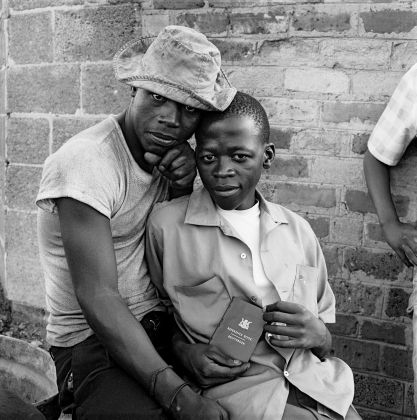 David Goldblatt, Young men with dompas (an identity document that every black South African had to carry), White City, Jabavu, Soweto 1972, silver gelatin photograph on fibre-based paper. Image courtesy Goodman Gallery, Johannesburg and Cape Town © The David Goldblatt Legacy Trust