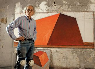 Christo in his studio with a preparatory drawing for The Mastaba, 2012. Photo: Wolfgang Volz © 2012 Christo
