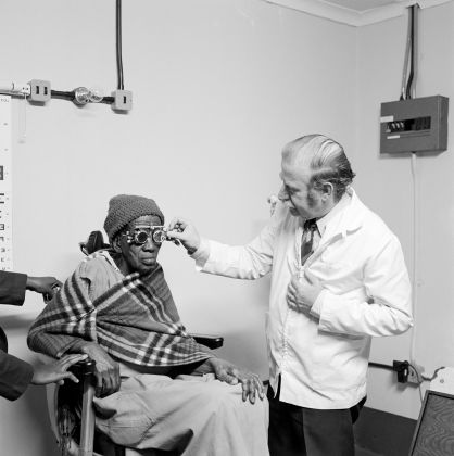 David Goldblatt, Eyesight testing at the Vosloosrus Eye Clinic of the Boksburg Lions Club 1980, silver gelatin photograph on fibre-based paper. Image courtesy Goodman Gallery, Johannesburg and Cape Town © The David Goldblatt Legacy Trust