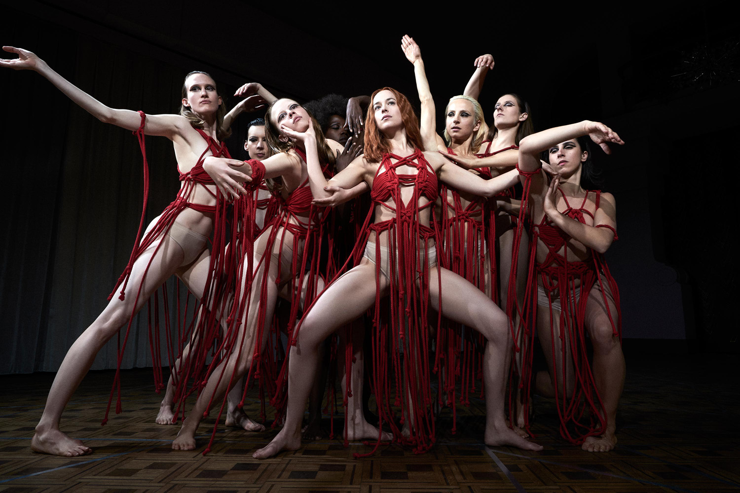 Dakota Johnson (center) and Mia Goth (center-left) star in SUSPIRIA. Photo: Alessio Bolzoni/Amazon Studios. Courtesy of Amazon Studios