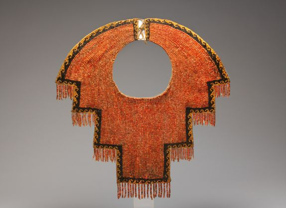 Collar 12th–14th century Peru, Chimú Spondylus shell and black stone beads, cotton, The Metropolitan Museum of Art, Purchase, Nathan Cummings Gift and Rogers Fund, 2003