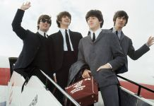 """The Beatles arrive at Speke airport, Liverpool on July 10, 1964, for the Liverpool premiere of their movie """"A Hard Day's Night"""". From left: John Lennon, Ringo Starr, Paul McCartney and George Harrison. (AP Photo)"""