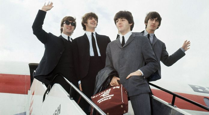 "The Beatles arrive at Speke airport, Liverpool on July 10, 1964, for the Liverpool premiere of their movie ""A Hard Day's Night"". From left: John Lennon, Ringo Starr, Paul McCartney and George Harrison. (AP Photo)"
