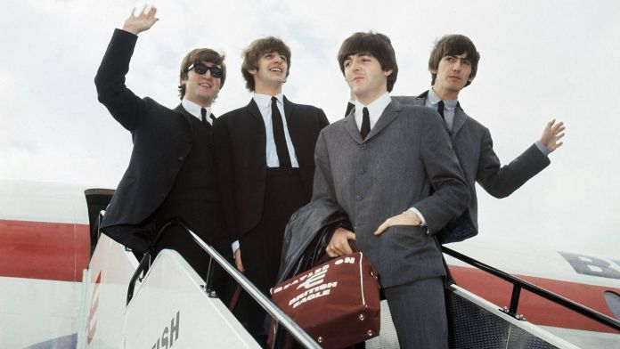 The Beatles arrive at Speke airport, Liverpool on July 10, 1964, for the Liverpool premiere of their movie