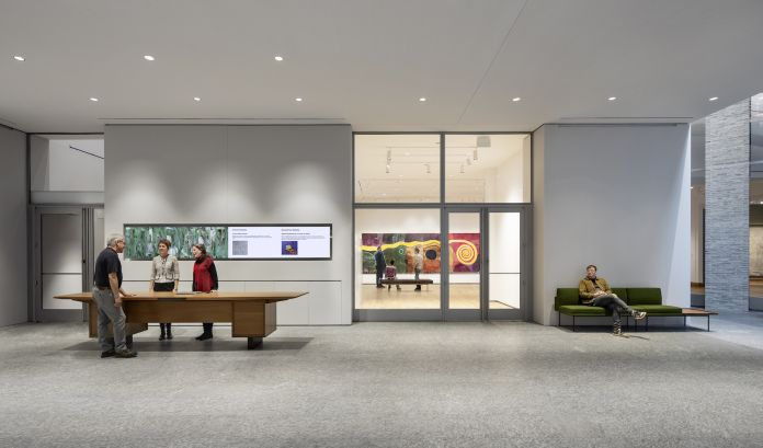 Inside the museum's new atrium, where partnered entrances to the center for object study and the galleries flank the expansive welcome desk. Photograph © Michael Moran. Courtesy of the Hood Museum of Art, Dartmouth.