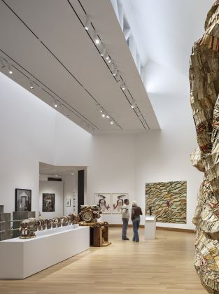 Looking across the Lathrop Gallery's installation of contemporary African art into the new north wing. Photograph © Michael Moran, Courtesy of the Hood Museum of Art at Dartmouth