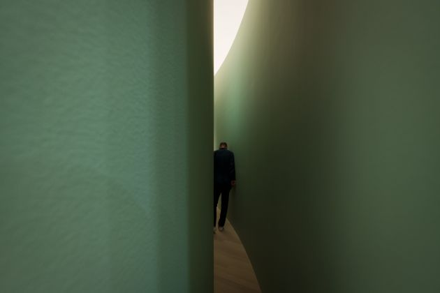 """Bruce Nauman (American, born 1941). Kassel Corridor: Elliptical Space. 1972. Painted wallboard, wood, and door hardware. Exhibition copy. Outer wall: 144 × 564"""" (365.8 × 1432.6 cm), Inner wall: 144 × 558"""" (365.8 × 1417.3 cm), Width at center: 27"""" (68.6 cm), Width at ends: 4"""" (10.2 cm). Solomon R. Guggenheim Museum, New York. Panza Collection. Installation view, Bruce Nauman: Disappearing Acts at The Museum of Modern Art, New York (October 21, 2018–February 25, 2019, at MoMA and MoMA PS1). © 2018 Bruce Nauman/Artists Rights Society (ARS), New York. Digital image © 2018 The Museum of Modern Art, New York. Photo: Martin Seck"""