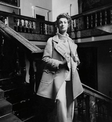 Marella Agnelli Wearing A Courreges Raincoat Photograph by Henry Clarke