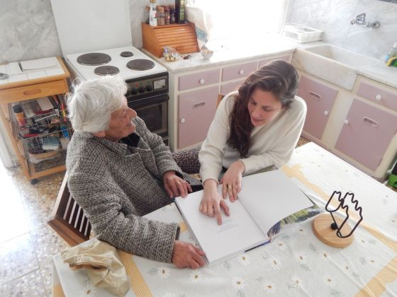 Mina Stone with her Yiayia looking at Cooking for Artists. Photo by Alex Eagleton