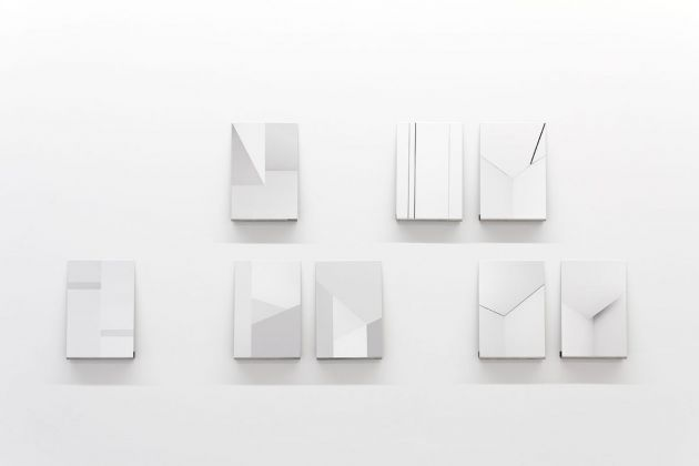 Michele Spanghero, Studies on the Density of White, 2010 – Ongoing, Inkjet prints on fine art paper mounted on stainless steel, displayed on stainless steel shelves, Unique +1EA 30 x 20 cm (work), 4 shelves: 2 x 20 x 3 cm, 1 shelf : 3 x 100 x 3 cm, courtesy Galleria Alberta Pane and the artist