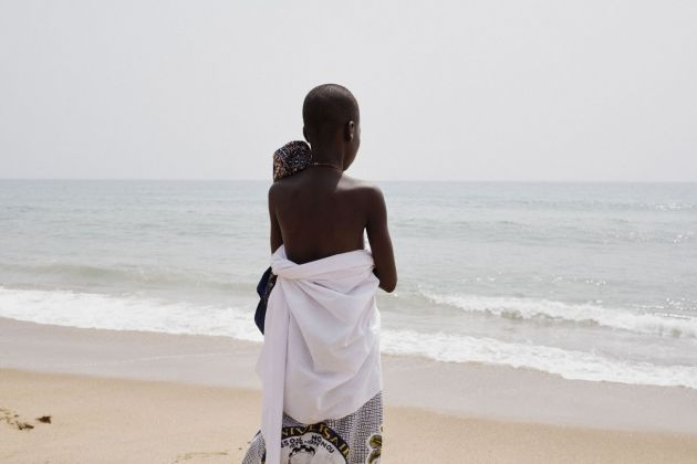 Francesco Bellina, A boy observes the sea during a voodoo ritual held on the beach. The Ocean is considered to be a divinity, Mami Waté, the Mother of the Water. Ouidah, Benin, 10th January 2018