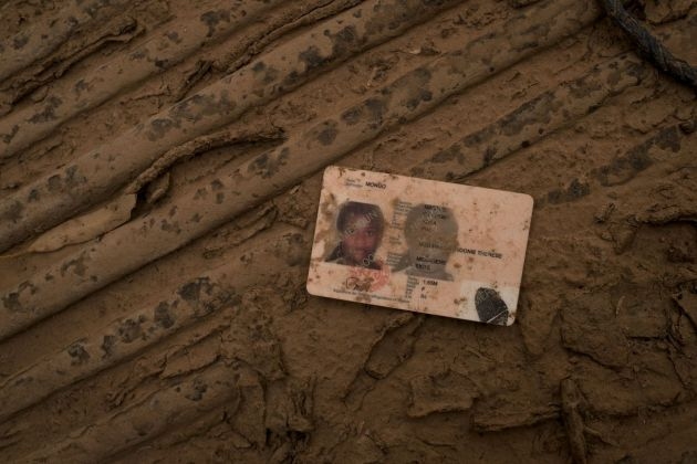 Francesco Bellina, The identity document of a Cameroonian woman, inside one of the pickup trucks confiscated from traffickers. Agadez, Niger, 2018