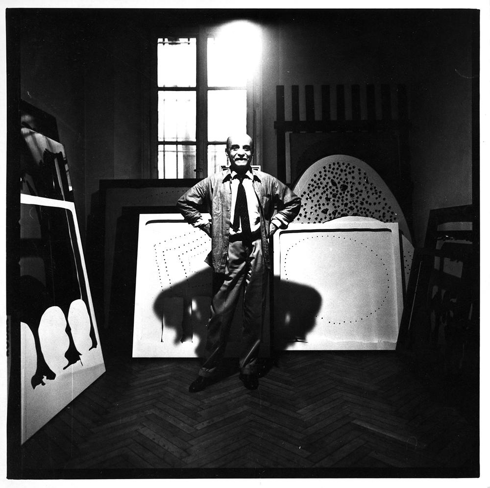 Lucio Fontana in his studio, Milan (Corso Monforte), ca. 1965 © Fondazione Lucio Fontana by SIAE 2019 Courtesy Fondazione Lucio Fontana, Milano