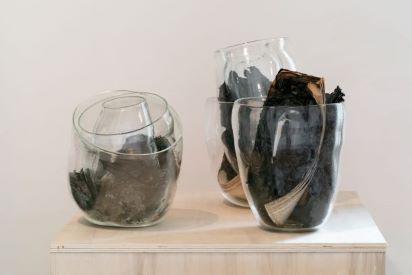 Henrik Strömberg, Strata Amnesic II, 2 handblown glass volumes, burned newspaper, sizes variable, 2019, ph. © Henrik Strömberg
