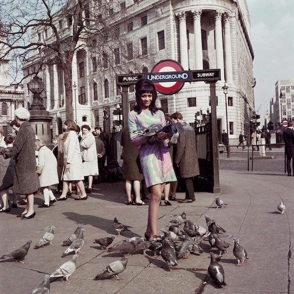 FotoFest2020_James Barnor, Drum Cover Girl Marie Hallowi at Charing Cross Station, London, 1966. Courtesy of Autograph ABP, London (1200x1200)