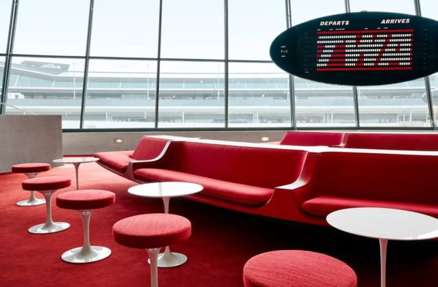 The Sunken Lounge at the TWA Hotel features its original Chili Pepper Red carpet and authentic penny tile. Photo credits TWA Hotel – David Mitchell