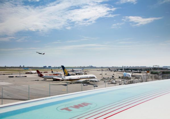 The TWA Hotel's rooftop infinity pool and observation deck overlooks JFK's bustling Runway 4 Left 22 Right. Photo credits TWA Hotel – David Mitchell