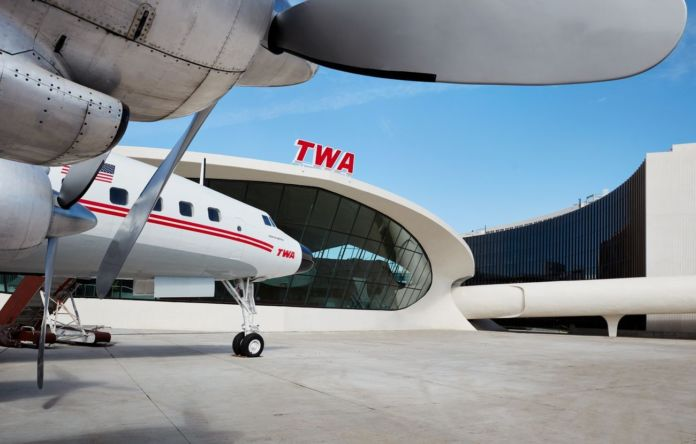"""Wind beneath her wings! The TWA Hotel's 1958 Lockheed Constellation """"Connie"""" airplane has been transformed into a cocktail lounge. Photo credits TWA Hotel – David Mitchell"""