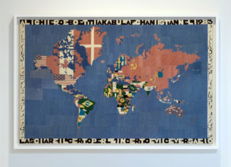 lighiero Boetti, Mappa, 1983, embroidery on fabric, 45 1/2 x 70 x 1 in. (115 x 177.8 x 2.5 cm). Photo by Marco Anelli. Courtesy the Olnick Spanu Collection.