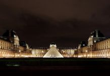 Louvre at night via Wikipedia