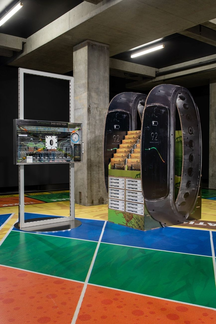 Simon Denny, Caterpillar Biometric worker fatigue monitoring smartband Extractor pop display, 2019. Courtesy of the artist & Galerie Buchholz. Photo Jesse Hunniford MONA