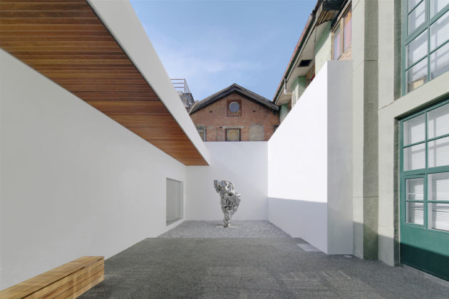 Sculpture of Zhan Wang in the renovated courtyard of Long March Space, image courtesy of Long March Space, photo by Wang Hongyue