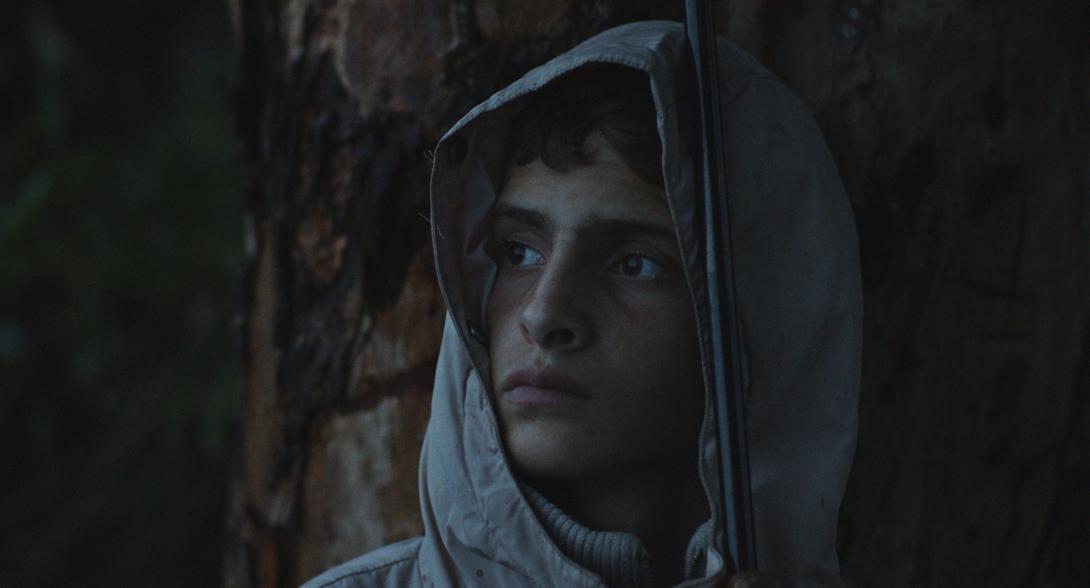Notturno a film by Gianfranco Rosi. Alì si ripara da una tempesta di vento e pioggia – Libano confine con Siria
