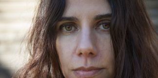 """PJ Harvey as featured in Seamus Murphy's film """"A Dog Called Money"""". His feature documentary on their collaboration traces the sources of the songs that were inspired by their travels, and tells stories of the some of the people and places they encounted along the way."""