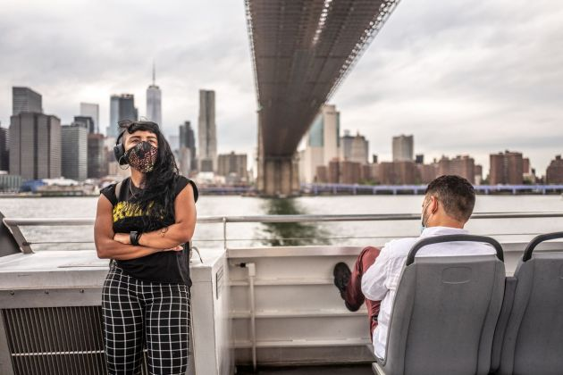 Francesca Magnani, A woman stands in front of me crossing her arms, Manhattan Bridge, East River Route, September 3 2020