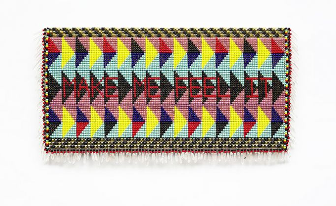 Jeffrey Gibson Make Me Feel It, 2015 Artificial sinew, glass beads, nylon fringe, steel and brass studs, and tin jingles on acrylic felt, mounted on canvas 21 5/8 x 55 in. (55 x 140 cm) Courtesy of the artist and Palazzo Monti