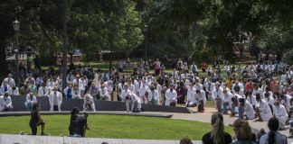 UVA medical students gathered at the Memorial to Enslaved Laborers and took a knee for nine minutes on June 5, 2020 (photograph by Sanjay Suchak / UVA Communications)