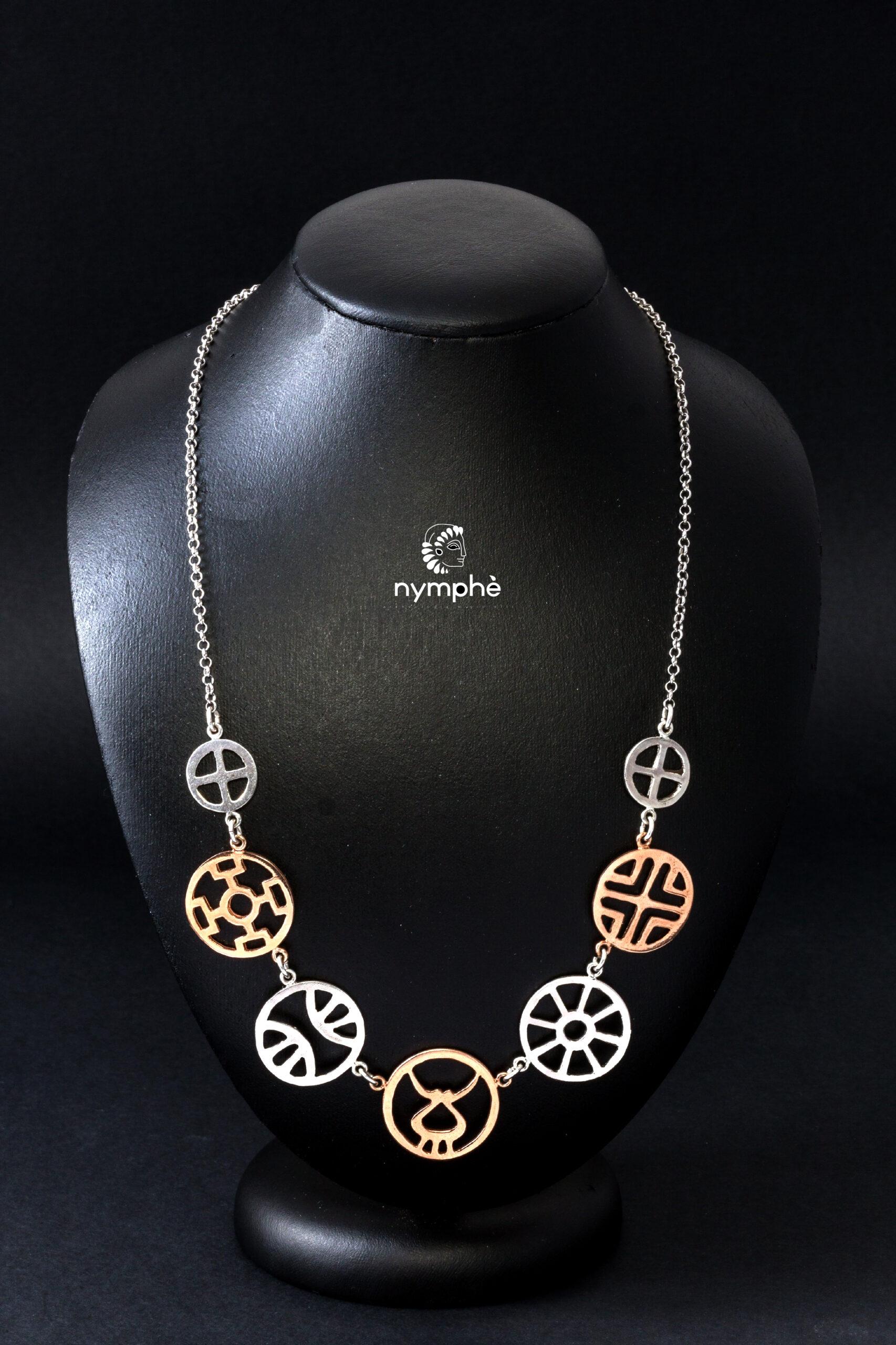Nymphè, Collana a ruote raggiate in argento bicolore ispirate a reperti dell'età del bronzo. Tecnica della fusione a cera persa