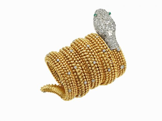 Serpenti bracelet watch in gold with emeralds eyes and diamonds, ca 1955