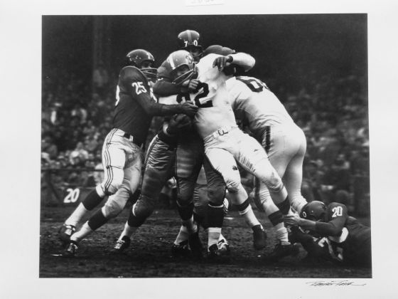 This is a famous shot, showing how many defensive players it took to take down Jim Brown, the famous fullback © Robert Riger